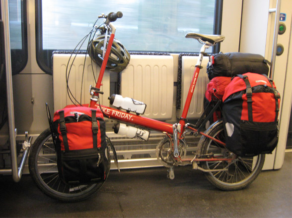 loaded Bike Friday folding bicycle on train with panniers