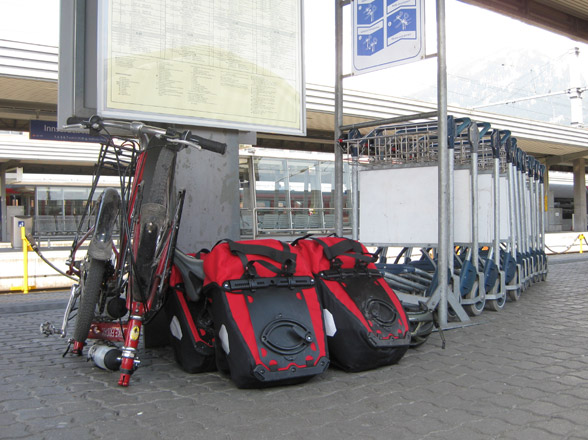 folded bike friday bicycle at train station with four panniers