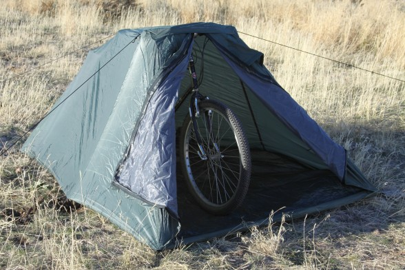 Bicycle holding up tent