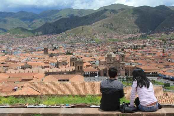 young teenagers looking down on the city of cuzco peru