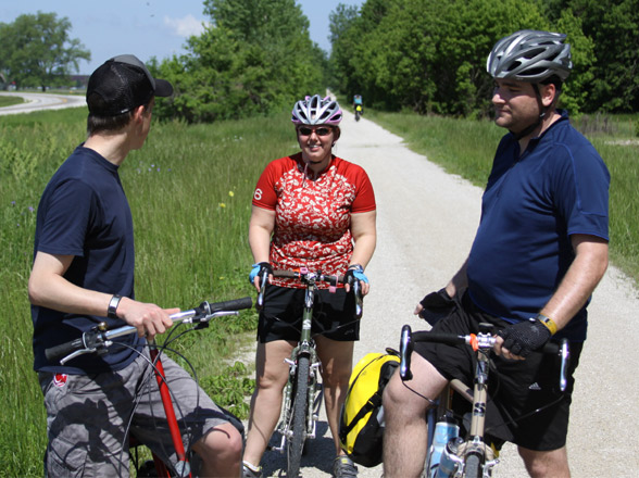 Three bicycle tourist asking one another for cycle touring advice