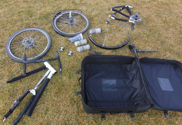 unpacked and unfolded Co-Motion Pangea touring bicycle and Co-Pilot travel case