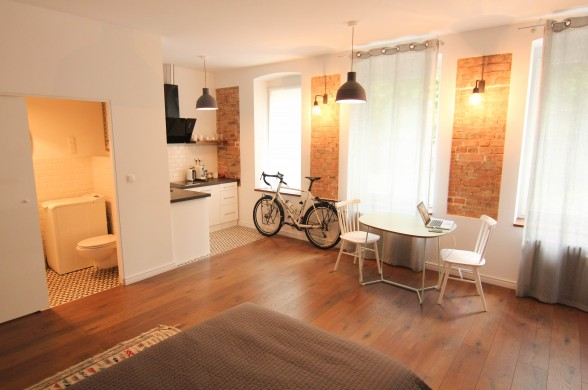 d6 Poznan Poland co-motion bicycle inside studio apartment