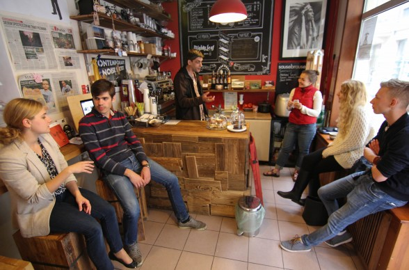 Customers gather inside the tiny Bigfoot Coffee Shop in Poznan, Poland