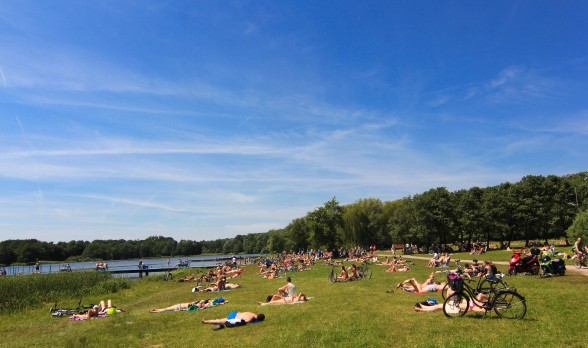 Poznan Poland Lake Rusalka during summer swimmers sunbathers