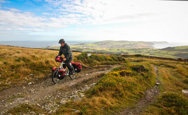 cyclist riding in mountains on the isle of man