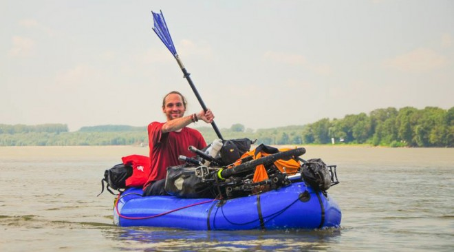 Casey Link floating down the river in his loaded packraft