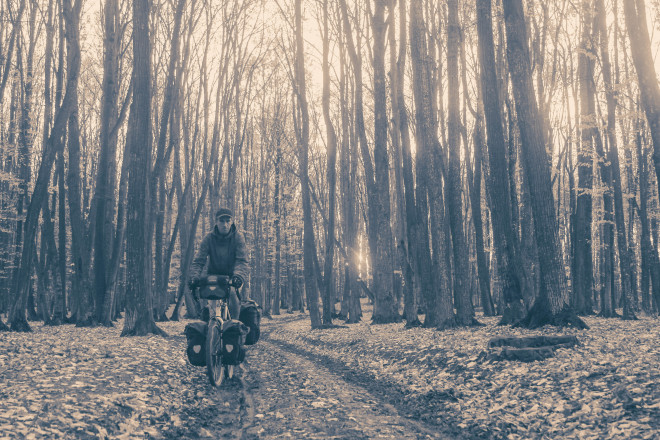 black-white-darren-alff-bicycle-touring-pro-forest-romania