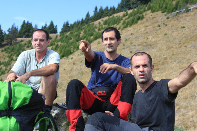 three-male-paragliders-hikers