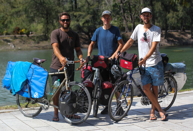 three young men on self-supported bicycle touring adventures