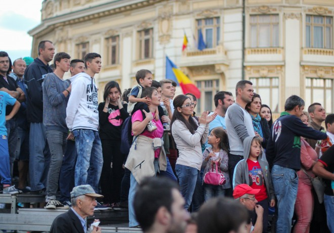 romanian flag and romani people in front of city hall building in sibiu romania
