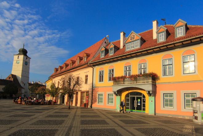 the main square in the center of sibiu romania with the clock tower in the background