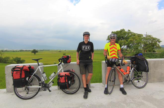 the bicycle touring pro and friend resting with their bikes in taiwan
