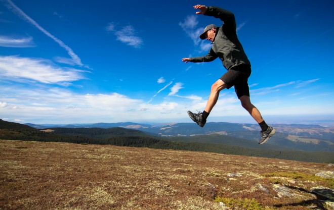 darren alff jumping 6 feet in the air with mountains in the background