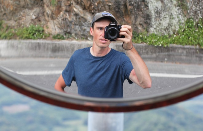 darren alff taking his photo in a curved road mirror