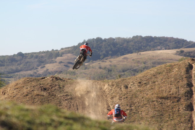 enduro motorcycle riders jumping in the air