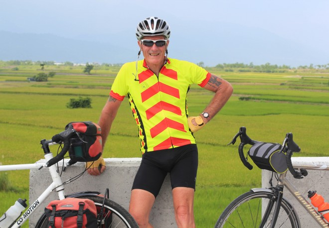 Kevin Burrett poses for a photo during his bicycle tour in taiwan