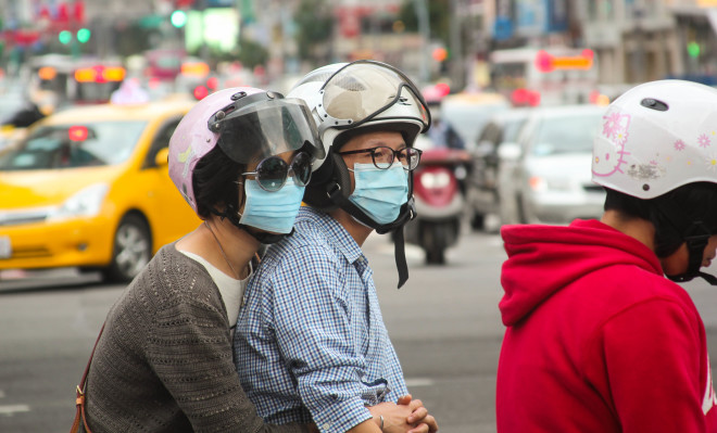 Asian scooter drivers wearing medical masks