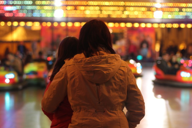 mother and daughter sharing a special moment at the bumper cars