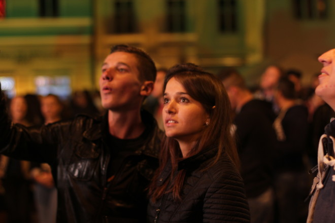 young teenagers looking up over crowd