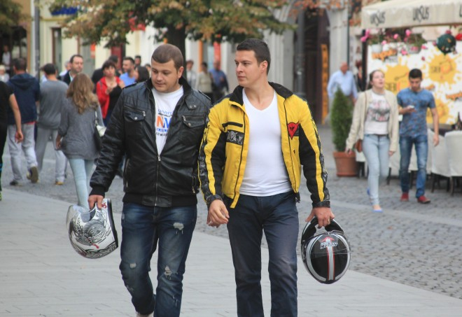 two young beefy men in motorcycle jackets
