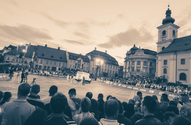 the centeral square in sibiu romania filled with onlookers in front of city hall building
