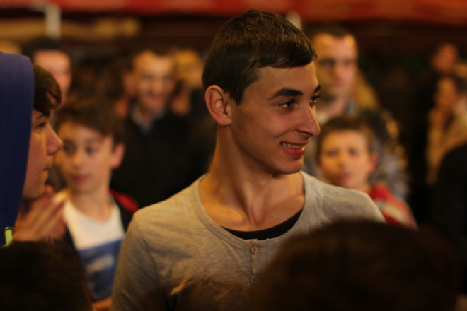 young smiling romanian boy in a crowd of people