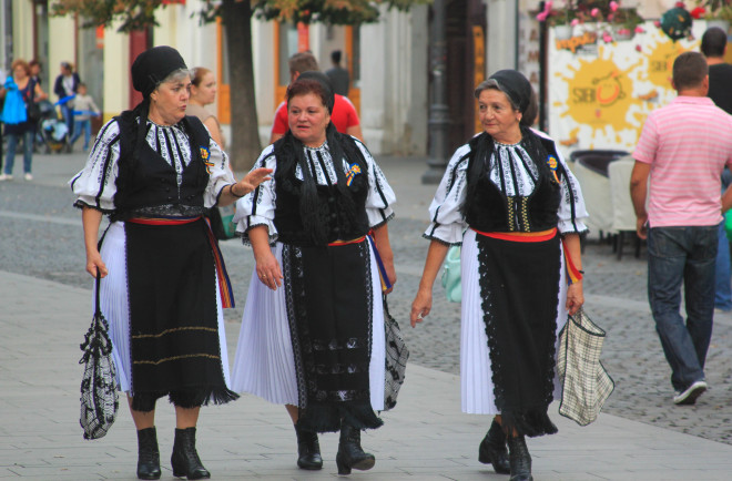 three old women in traditional romanian dresses