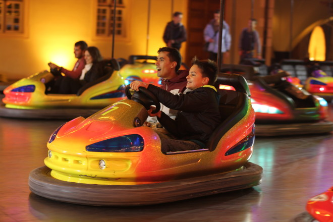 boys driving bumper car and having fun