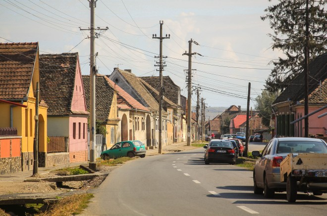 typical romanian street with houses and cars parked alongside