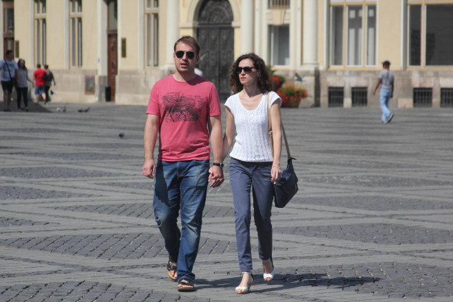 romanian couple holding hands