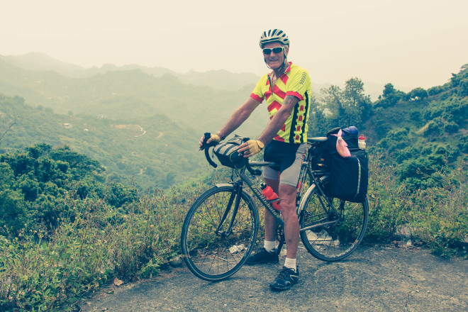 Kevin Burrett with bicycle in Taiwan mountains