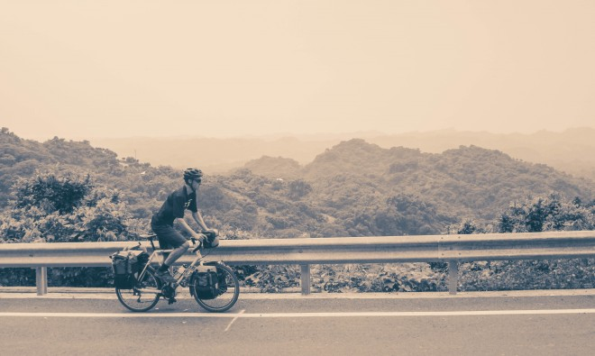 bicycle touring pro Darren Alff cycling uphill in the mountains of Taiwan