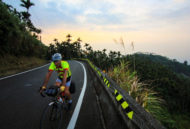 male cyclist riding on mountain road