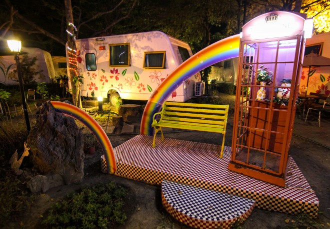 themed RV park with rainbow telephone booth