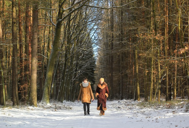 Kaska and Karolina walking in Poland forest in wintertime