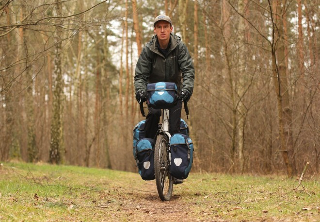 denim blue ortlieb panniers on touring bicycle in poland